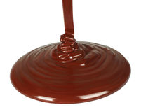 Melted chocolate dripping on white background Royalty Free Stock Photo