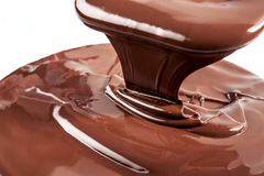 Melted chocolate. Flow. Close-up view Stock Photography