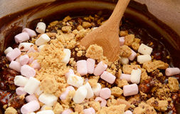 Melted chocolate, marshmallows and crushed biscuits Stock Image