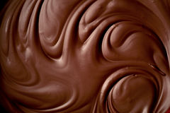 Melted chocolate swirl background. Close up royalty free stock photography