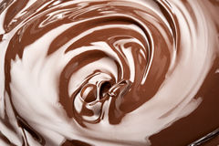 Melted chocolate. Swirl background. Close-up view Royalty Free Stock Photos