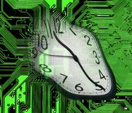 Melted clock. An image of melted clock on green computer circuitboard Royalty Free Stock Images