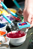 Melted Crayons Are Poured Into Mold For Art Project Royalty Free Stock Photography