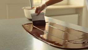 Melted Dark Chocolate mixing on a table Video Footage HD 1080p. stock footage