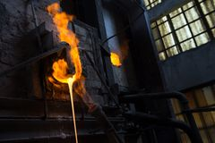 Melted glass furnace in glass factory Stock Image