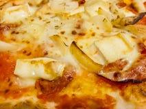Melted golden cheese on Italian pasta Stock Photos