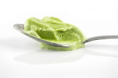 Melted green tea ice cream on teaspoon Stock Image