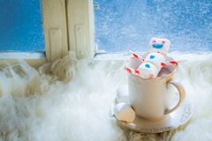 Melted in hot chocolate snowman made of marshmallows for xmas stock images
