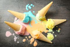 Melted ice-cream cones. On gray background royalty free stock photo
