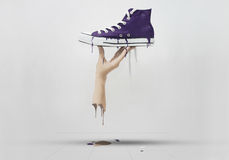 Melted Sneakers and Hand Royalty Free Stock Images