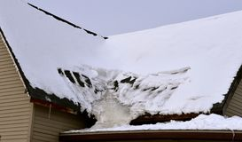 Free Melted Snow Creates Creates An Ice Sheet On A Roof Royalty Free Stock Photos - 141183728