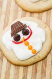 Melted snowman cookie Stock Images