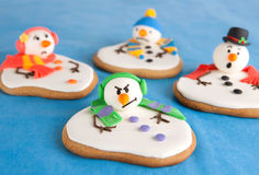 Melted snowman cookies Stock Photos