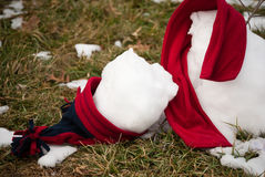 Melted snowman on grass Stock Photography