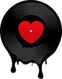 Melted vinyl record with heart Royalty Free Stock Photo