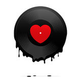 Melted vinyl record with heart Stock Photo