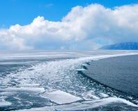 Melting. Ice. Lake Baikal. Mountains on the horizon Stock Photos