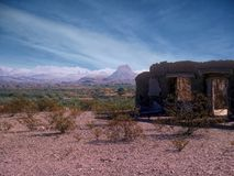 Melting Adobe Ruins in Big Bend National Park, TX, USA. The Dorgan-Sublett homestead near Castalon, TX in what is now Big Bend National Park; Pale peaks in the Royalty Free Stock Photography