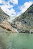 Melting Briksdal glacier in Norway, close up. Panorama from bottom to top. Norway nature and travel background stock images