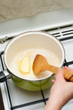 Melting butter. A chef melting butter in a pot Stock Photos