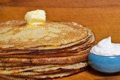 Melting butter pat on a pile of pancakes. Fried pancakes are usually roasted in all Orthodox families for the Orthodox holiday `Maslennitsa`. As a symbol of Royalty Free Stock Images