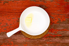 Melting Butter on White Serving Plate with handle Stock Image