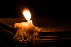 Melting candle Royalty Free Stock Image