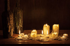 Melting candle in wooden shelf Stock Image
