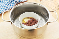 Melting chocolate. In a hot water bath Stock Image
