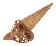 Melting Chocolate Ice Cream Cone. Melting chocolate flavour ice cream cone isolated on a white background Stock Image