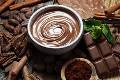Melting chocolate or melted chocolate with a chocolate swirl. M. Any stack and chips with powder stock image