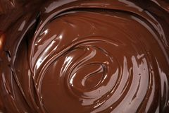 Melting chocolate, melted delicious chocolate for praline icing. Confectionery stock images