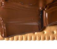 Melting chocolate on shortbread Stock Photos