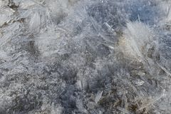 Melting of coaceously located ice crystals of various shapes. On a spring day royalty free stock photography