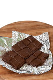 Melting cooking chocolate on the kitchen board Royalty Free Stock Photo