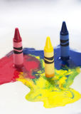Melting crayons. A set of three crayons melting Stock Photography