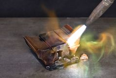 Melting down a copper cooling element Stock Photo
