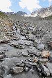 Melting Glacier. A stream fed by the water of a glacier on Mt. Ortler in the Alps. The glaciers in the Alps are shrinking year by year. Evidence of Global stock images