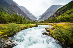 Melting Glacier. The river formed by melting Glacier. Briksdalsbreen. Norway Royalty Free Stock Image
