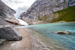 Melting Glacier. The lake formed by melting Glacier. Briksdalsbreen. Norway Royalty Free Stock Photo
