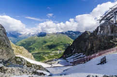 Melting glacier and the lake of clear blue water at an altitude of 2400 meters in the Alps Stock Photos