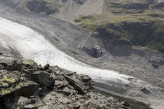 Melting glacier with moraine in the valley morteratsch, engadin Stock Photo