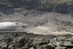 Melting glacier with moraine in the valley morteratsch, engadin Royalty Free Stock Photos