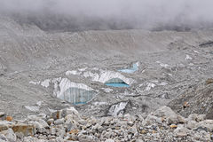 Melting glaciers near the top of Everest Base Camp due to global warming. This image shows 3 little pools that will grow larger over time formed due to melting Stock Photos