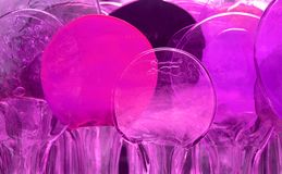 Melting Glass Circles. Closeup of colourful glass circles that are melting Royalty Free Stock Images