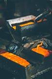 Melting gold at a mill Royalty Free Stock Photos