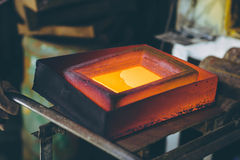 Melting gold at a mill Royalty Free Stock Photography