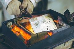 Melting gold at a mill Stock Photos
