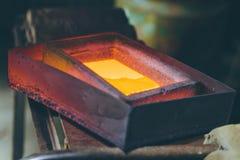 Melting gold at a mill Royalty Free Stock Photo