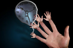 Melting Hands of Time. Open hand and fingers with hands reaching for melting clock Royalty Free Stock Photo